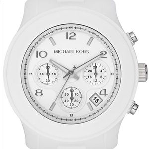 MK White stainless steel Watch w a silicone strap.